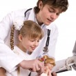 Doctor learn child to do  inoculation. - Foto de Stock