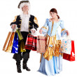 Girl and man in ancient dress with gift bag shopping. — Stock Photo