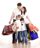 Happy family and children shopping. — Foto de Stock