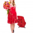 Traveling young woman with wheeled luggage — Stock Photo
