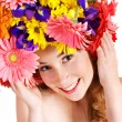 Young woman with with flowers on her hair. — Stock Photo #8633024