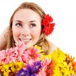 Happy young woman holding flowers. — Stock Photo #8633030