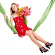 Young woman holding flowers on swing. — Stock Photo #8633046