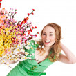 Beautiful girl with spring flower. - Stock Photo
