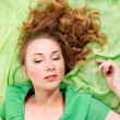Sleeping  woman in green dress. - Stock Photo