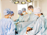 Woman on gurney in operating room. — Stock Photo
