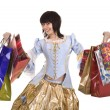 Royalty-Free Stock Photo: Woman in ancient dress with gift bag shopping.