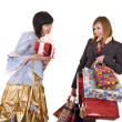 Two beautiful girlfriends enjoy shopping. — Stock Photo #8640338
