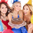 Group holding cake. — Photo