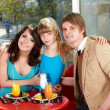 Stock Photo: Family with child in restaurant.