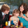 Happy family with child in cafe. — Stock Photo #8644384