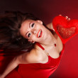Girl with heart in red flying. Valentines day. — Stock Photo #8645559