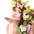 Girl with butterfly and flower on head. - Stock Photo