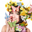 Girl with butterfly and flower. Beauty and fashion. - Stockfoto