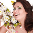 Girl with spring flower and butterfly. — Stock Photo