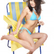 Girl in bikini on beach chair. - ストック写真