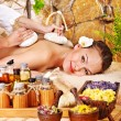 Woman getting thai herbal compress massage . — ストック写真