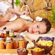 Woman getting thai herbal compress massage . — Stock fotografie