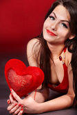 Girl with heart on red background. — Foto Stock