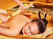 Bamboo massage. — Stock Photo