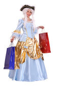 Woman in ancient dress with shopping bags — Stock Photo