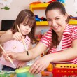 Child with teacher in preschool. - Stock Photo
