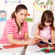 Stock Photo: Group child and teacher mould from clay in play room.