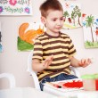 Child paint picture in preschool. — Stock Photo #8652244