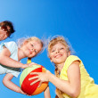 Stock Photo: Mother and children playing with ball.