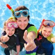 Children with mother in swimming pool. — Stock Photo #8657937