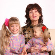 Happy grandmother and two granddaughter. - Stock Photo