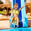Child on water slide at aquapark. - Photo
