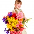 Happy child giving flowers. — Stock Photo #8658485
