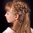 Stock Photo: Rear view of hairstyle with braiding.