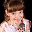 Singing of child in microphone. - Stock Photo