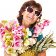 Senior woman holding bunch of flowers. - Stock Photo