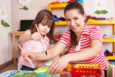 Child with teacher in preschool. — Stock Photo