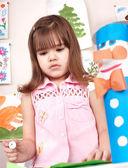Child preschooler with glue in classroom. — Stock Photo