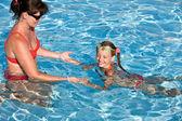 Child learn swim in swimming pool. — Stock Photo