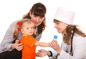 Family doctor and little girl. — Stock Photo