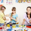 Children painting in preschool. - Stock Photo