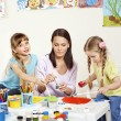 Stock Photo: Child painting in preschool.