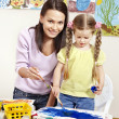 Child painting in preschool. — Stock Photo #8664843