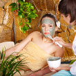 Stock Photo: Young woman having clay body mask.