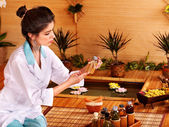 Bamboo massage at spa. — Stock Photo