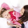 Sick child with mother. Isolated. - Foto Stock