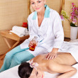 Young woman on massage table in beauty spa. - Foto Stock