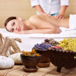 Still life with woman on massage table in beauty spa. - Foto Stock