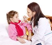 Doctor take child temperature — Stock Photo