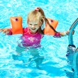 Child with armbands in swimming pool — Stock Photo #9068686